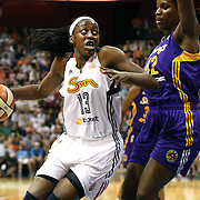Chiney Ogwumike, Connecticut Sun, drives to the basket defended by Jantel Lavender, Los Angeles Sparks, during the Connecticut Sun Vs Los Angeles Sparks WNBA regular season game at Mohegan Sun Arena, Uncasville, Connecticut, USA. 3rd July 2014. Photo Tim Clayton