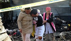 SOUTH AFRICA - Cape Town - 02 June 2020 - Family members on the scene where a family was killed in a devastating fire in Kalkfontein in Kuilsriver. A man woman and two girls aged 2 and 10 were trapped in the informal structure and died in the blaze. Picture:Brendan Magaar/African News Agency (ANA)