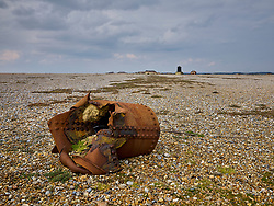 A shattered canister, perhaps a bomb casing, still lies on the shingle at the former Atomic Weapons Research Establishment at Orford Ness in Suffolk