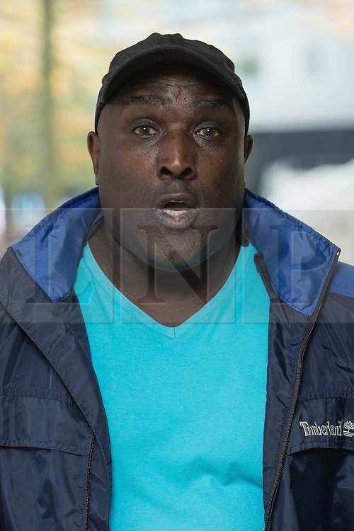 """© Licensed to London News Pictures . 23/10/2013 . Manchester , UK . AKINWALE AROBIEKE (aka PURPLE AKI ) leaves Manchester Crown Court this afternoon (23rd October 2013) . Having been cleared of breaching a ban on touching men's muscles he now faces charges related to police harassment , namely he is alleged to have left Detective Sergeant Lewis Hughes """"to fear that violence would be used against him"""" following an incident in Birmingham Town Hall on 7th October 2012 . Photo credit : Joel Goodman/LNP"""