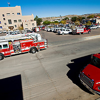 102312       Cable Hoover<br /> <br /> Gallup Fire Department trucks surround the McKinley County Courthouse where the staff was evacuated after a reported gas leak Tuesday morning. The building was fully inspected by GFD and cleared of any danger.