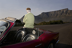 Cape Town - Senior Man Admires View Leaning On Vintage Racing Car - 16 Mar 2016
