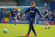 AFC Wimbledon defender Steve Seddon (15), AFC Wimbledon defender Will Nightingale (5), and AFC Wimbledon midfielder Anthony Hartigan (8) warming up during the EFL Sky Bet League 1 match between AFC Wimbledon and Bristol Rovers at the Cherry Red Records Stadium, Kingston, England on 19 April 2019.