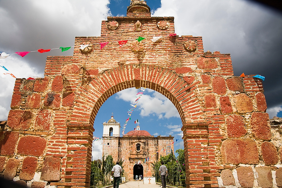 People walk towards the small Spanish colonial church in the indigenous Zapotec village of Magdalena Teitipac, Oaxaca state, Mexico on July 22, 2008.