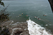 Surfers line up at the point break at Batu Karas on the 27th October 2019 in West Java in Indonesia.