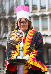 © Licensed to London News Pictures. 13/02/2018. London, UK. Contestants take part in the annual Inter-Livery Pancake Race at Guildhall Yard in the City of London. The race component of the event had to be abandoned owing to bad weather. Photo credit: Rob Pinney/LNP