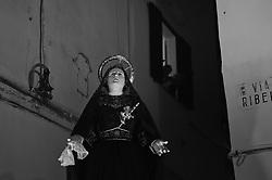 Gallipoli - Processione dei Misteri e della Tomba di Cristo che precede la Pasqua. Nella sacrestia della chiesa sono conservate le statue dei Misteri Dolorosi: esse vengono portate in processione dal tramonto del Venerdì Santo alle prime ore del Sabato Santo. La processione è preceduta dai lampioni e dal suono di alcuni strumenti musicali tradizionali, come la trozzula (uno strumento in legno con battenti metallici), la la tromba ed al tamburo scordato. La Processione dei Misteri e della Tomba di Cristo è una delle processioni più suggestive e coinvolgenti della ritualistica tradizionale, cui partecipa la Confraternita di S. Maria degli Angeli con il simulacro di Maria Santissima Addolorata.<br /> Gallipoli - Procession of the Mysteries and the Tomb of Christ before Easter. In the sacristy of the church there are the statues of the Sorrowful Mysteries: they are carried in procession from sunset Friday to the early hours of Holy Saturday. The procession is preceded by the street lamps and the sound of some traditional musical instruments, such as the trozzula (a wooden instrument with metal doors), the trumpet and the drum tune. The Procession of the Mysteries and the Tomb of Christ is one of the most charming and engaging processions of traditional rituals, involving the Brotherhood of St. Maria degli Angeli with the statue of Our Lady of Sorrows.