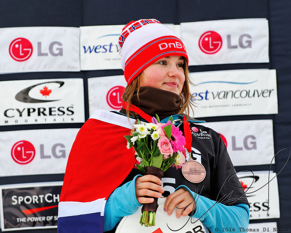 Helene Olafsen (NOR) celebrates her bronze medal performance during the awards ceremony for the Ladies Snowboard-Cross event at the LG Snowboard World Cup held at Cypress Mountain, British Columbia on February 13th, 2009. Mandatory Photo Credit: Bella Faccie Sports Media\Thomas Di Nardo. Contact: Thomas Di Nardo, Snohomish, Washington, USA. Telephone 425-260-8467. e-mail: tom@bellafaccie.com