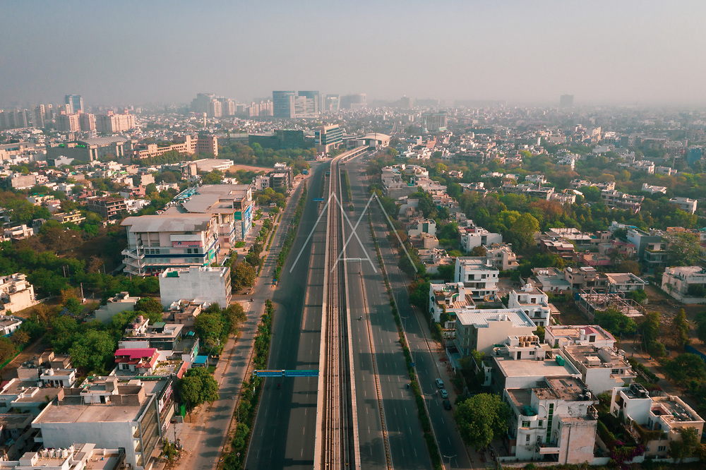 Aerial view of the wide road in Gurugram near New Delhi during lockdown, India.