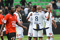 FOOTBALL - FRENCH CHAMPIONSHIP 2009/2010 - L1 - STADE RENNAIS v FC SOCHAUX - 2/05/2010 - PHOTO PASCAL ALLEE / DPPI - DESPERATE ASAMOAH GYAN (REN) CONTRASTE WITH JUBILATION SOCHAUX PLAYERS  AFTER WIN THE GAME