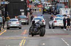 28JUL21 Batman on his bike as filming of The Flash happens on George St.