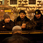 December 18, 2013 - Kiev, Ukraine: Pro-EU demonstrators listen to a man playing the piano at Independence Square.<br /> On the night of 21 November 2013, a wave of demonstrations and civil unrest began in Ukraine, when spontaneous protests erupted in the capital of Kiev as a response to the government's suspension of the preparations for signing an association and free trade agreement with the European Union. Anti-government protesters occupied Independence Square, also known as Maidan, demanding the resignation of President Viktor Yanukovych and accusing him of refusing the planned trade and political pact with the EU in favor of closer ties with Russia.<br /> After a days of demonstrations, an increasing number of people joined the protests. As a responses to a police crackdown on November 30, half a million people took the square. The protests are ongoing despite a heavy police presence in the city, regular sub-zero temperatures, and snow. (Paulo Nunes dos Santos/Polaris)