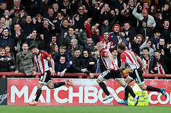 Scott Hogan of Brentford celebrates his goal as he makes it 1-1 - Mandatory by-line: Dougie Allward/JMP - 16/04/2016 - FOOTBALL - Griffin Park - Brentford, England - Brentford v Bristol City - Sky Bet Championship