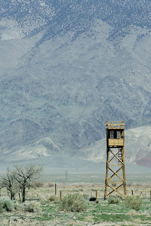INDEPENDENCE, CA, March 19, 2008: A guard tower at Manzanar, one of ten remote War Relocation Centers in the United States where 11,000 Japanese were sent beginning in early 1942 during World War II. Not trusting those with cultural ties to Japan who had bombed Pearl Harbor, the U.S. Government enclosed a  one square mile, remote area in the Eastern Sierra mountains with barbed wire and erected a mini city complete with churches, barracks, mess halls, hospitals and even baseball fields. A cemetery and graves still adorn the property which is now a National Historic Site.