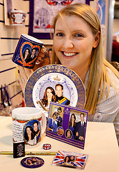 © under licence to London News Pictures. 08/02/2011. Thousands of trade visitors flocked to the Spring Fayre at the NEC in Birmingham to buy this years must have gifts. Top of the list this year, Royal Souvenirs ready for the Royal Wedding in April, everything from a pin badge to forty foot flag were on display. Mugs, erasers, fridge magnets, pencils, cards, keyrings, everything is available to buy before the big day. Pictured, Hannah Griegg takes a closer look at gifts available..Picture credit: Dave Warren/London News Pictures...