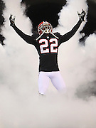Cornerback Asante Samuel of the Atlanta Falcons comes out of the tunnel during pre-game introductions before a game in 2012.