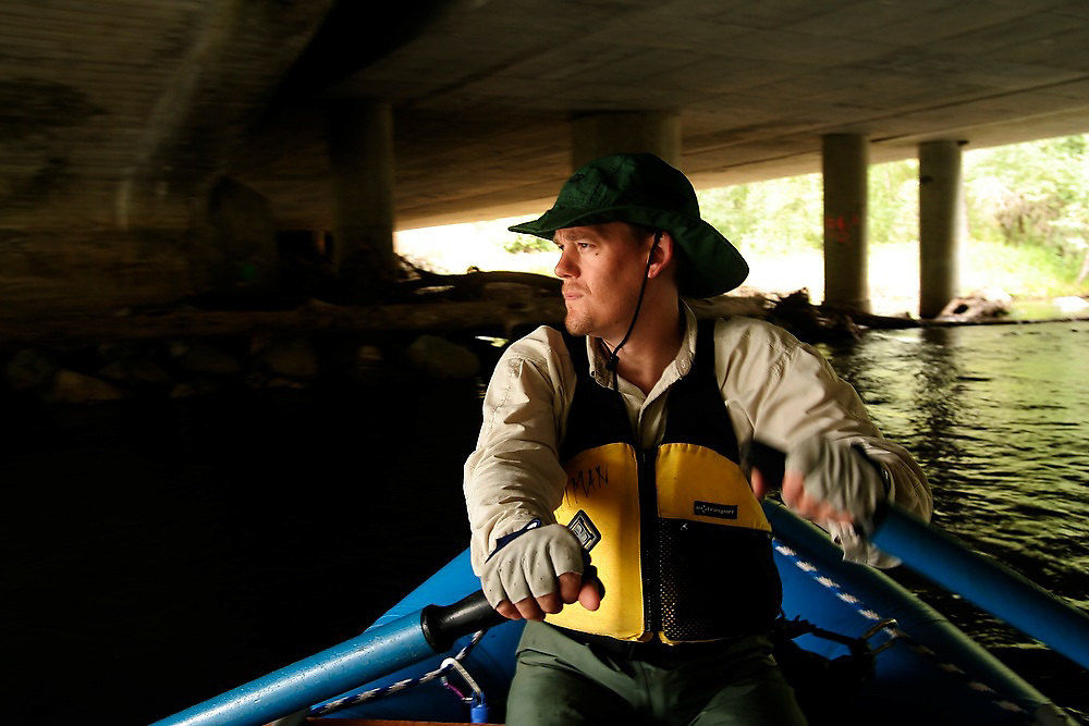 A fisheries biologist paddles down the Yakima River, near Cle Elum, Washington, during a USGS and NOAA fish habitat survey.