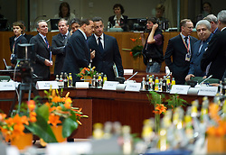 Silvio Berlusconi, Italy's prime minister, left center, speaks with Nicolas Sarkozy, France's president, right center, during the European Summit meeting at EU Council headquarters in Brussels, Belgium, on Thursday, June 17, 2010. (Photo © Jock Fistick)