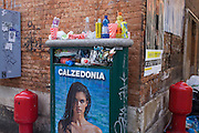 Early morning rubbish overspilling a litter bin in Dorsoduro, a district of Venice, Italy.