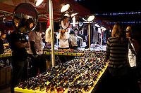 Female Shoppers Trying on Sunglasses, Richmond Night Market, B.C.