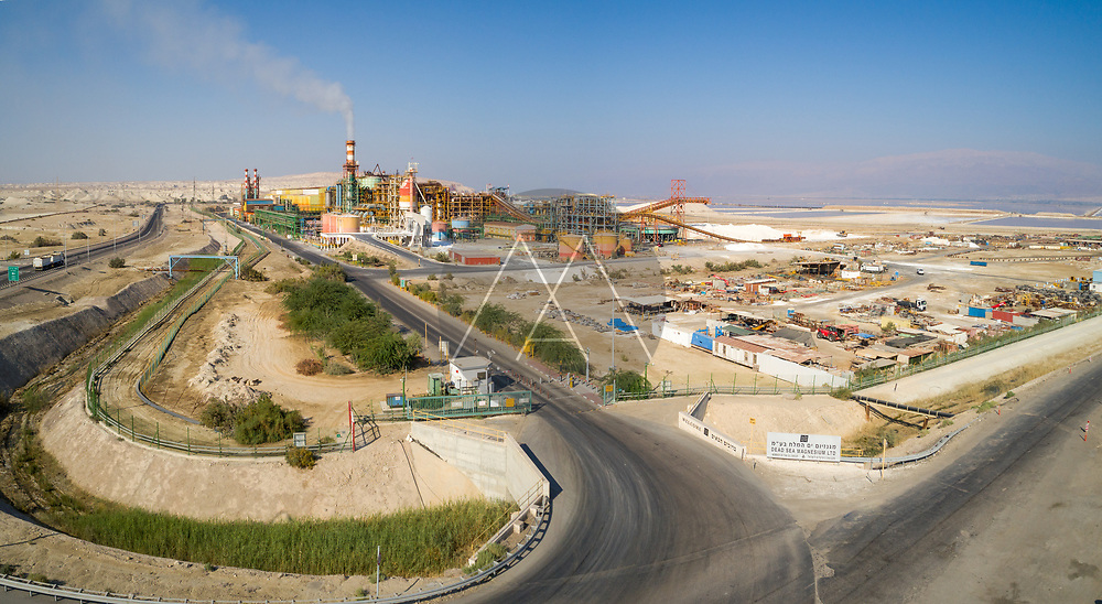 Dead Sea, Negev, Israel -  25 September 2018. Aerial view of the entrance to industrial zone with smoking chimney.