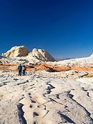 Two hikers enjoy the beautiful scenery at White Pocket, Paria Plateau, Vermilion Cliffs National Monument, Arizona.