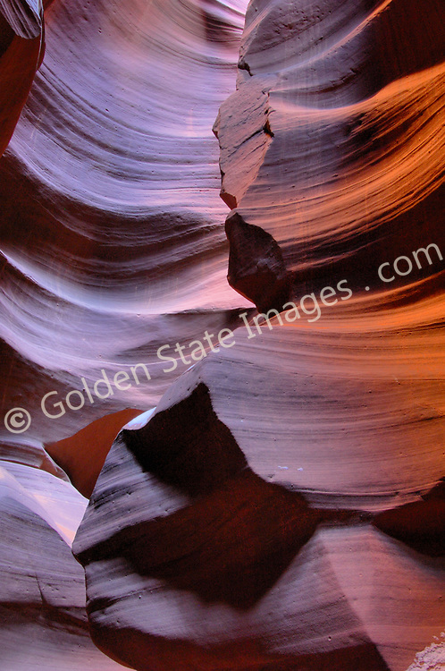 Antelope Canyon is located on LeChee Navajo lands near Page Arizona.  The area is managed by the Navajo Tribe.  <br /> Sandstone slot canyons are formed over centuries by the scouring action of water from storm runoff and wind. <br /> Depending on the time of day the curving walls glow in shades of red orange and yellow.   <br /> <br /> Upper Antelope Canyon is also known as The Corkscrew.