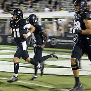 ORLANDO, FL - NOVEMBER 14:  Dillon Gabriel #11 of the Central Florida Knights runs onto the field in a game against the Temple Owls at Bounce House-FBC Mortgage Field on November 14, 2020 in Orlando, Florida. (Photo by Alex Menendez/Getty Images) *** Local Caption *** Dillon Gabriel