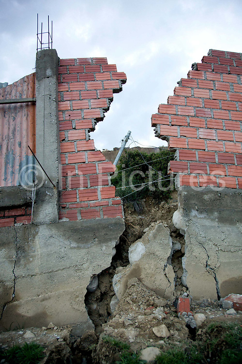 A wall cracked in half as a result of a major lansdlide in La Paz in 2011, which made around 25,000 people homeless, due to heavy rain and poor infrastructure, there were no fatalities and only minor injuries sustained