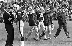 1964 Oakland Raiders...coach Al Davis talking to his quarterback Tom Flores who is going to replace #19 Cotten Davidson who is injured. Trainer George Anderson and equipment man Dick Romanski.<br />(1964 photo by Ron Riesterer) At Frank Youell Field in Oakland.