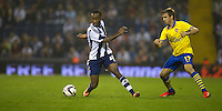 West Bromwich Albion's Saido Berahino is watched by Arsenal's Nacho Monreal<br /> <br /> Photo by Stephen White/CameraSport<br /> <br /> Football - Capital One Cup Third Round - West Bromwich Albion v Arsenal - Wednesday 25th September 2013 - The Hawthorns - West Bromwich<br />  <br /> © CameraSport - 43 Linden Ave. Countesthorpe. Leicester. England. LE8 5PG - Tel: +44 (0) 116 277 4147 - admin@camerasport.com - www.camerasport.com