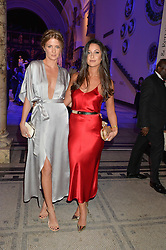 Left to right, MILLIE MACKINTOSH and ROXIE NAFOUSI at a private view of Alexander McQueen's Savage Beauty exhibition hosted by Samsung BlueHouse at the V&A, London on 30th March 2015.