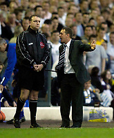 Photo: Jed Wee.<br /> Leeds United v Preston North End. Coca Cola Championship. Play-off, First Leg. 05/05/2006. <br /> <br /> Preston manager Billy Davies (R) complains to an impassive fourth official Carl Boyeson.