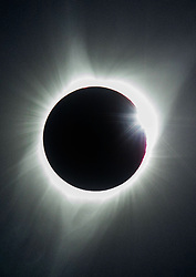 Aug 21, 2017 - Corvallis, Oregon, U.S. - The diamond ring effect occurs as the sun's rays reemerge from behind the moon during a total solar eclipse over farm fields along Church Road south of Corvallis. (Credit Image: © Brian Davies/Register Guard via ZUMA Wire)