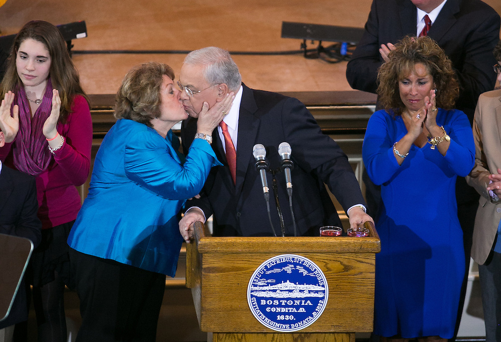 Boston, MA 03/28/2013<br /> Boston Mayor Thomas M. Menino hisses his wife Angela after announcing that he will not seek re-election at Faneuil Hall on Thursday afternoon.