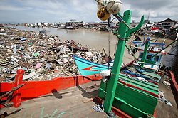 Almost the entire  Banda Aceh fishing fleet was completely destroyed as the tsunami came rushing up the river into town bringing with it most of the anchored trawlers and crushing them on the first bridge across the river.  Only boats that were out at sea survived.
