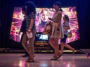 20 NOVEMBER 2014 - BANGKOK, THAILAND: People walk past a movie theater showing the new Hunger Games movie in Bangkok. At least three people were arrested by Thai police during the opening the Hunger Games: Mockingjay - Part 1 in Bangkok Thursday. Opponents of the Thai military coup have adapted the three fingered salute used in the Hunger Games series as a sign of their opposition to the coup. In the weeks before the movie opening Thai police arrested several people for using the Hunger Games salute and Thai media reported that one Thai movie theater chain cancelled plans to show the movie at the request of the military government. There were several small protests at theaters showing the movie Thursday.     PHOTO BY JACK KURTZ