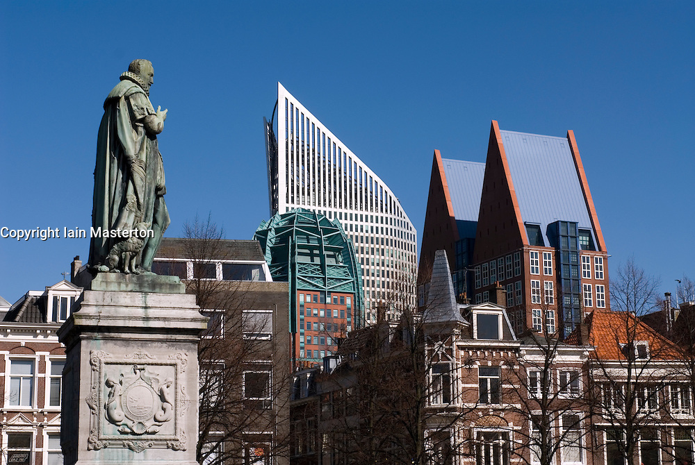 Contrast of old statue and new office building in the Plein Square in The Hague Netherlands Europe