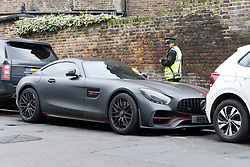 © Licensed to London News Pictures. 06/03/2019. London, UK.  A traffic warden walks past Stoke City footballer, Saido Berahino's car after giving it a parking ticket outside Highbury Corner Magistrates court. The Stoke City and Burundi striker, Saido Berahino has been charged with drink-driving.  Photo credit: Vickie Flores/LNP