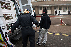 © Licensed to London News Pictures. 01/11/2015. London, UK. A woman being arrested by police. The scene where Riot police clashed with party goers at the site of an illegal halloween rave in London where it has been reported that a petrol bomb was thrown. Photo credit: Ben Cawthra/LNP
