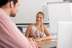 Young man woman office meeting friendly computer