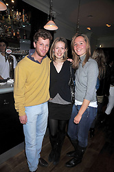 Left to right, FELIX KUNA, LILI ROSBOCH and JULIA VAN HAGEN at the opening of the Brompton Bar & Grill, 243 Brompton Road, London SW3 on 11th March 2009.