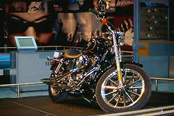 harley davidson motor cycle as seen at the Chicago Auto Show in February 2001 at McCormick Place, Chicago Illinois...This image was scanned from a slide, print or transparency.  Image quality may vary.  Dust and other unwanted artifacts may exist.