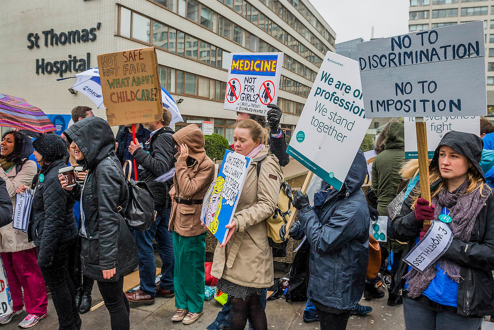 The protest continues despite the miserable weather - The picket line at St Thomas' Hospital. Junior Doctors stage another 48 hours of strike action against the new contracts due to be imposed by the Governemnt and health minister Jeremy Hunt.