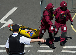 © Licensed to London News Pictures. 30/06/2015. London, UK. Medics carrying an injured member of the public from the building. Members of the emergency service take part in a mocked-up terrorist firearms attack at Aldwych station in central London. The exercise is the biggest to take place in London and is happening a week after dozens of people where killed when a gunman opened fire on a beach in Tunisia.  Photo credit: Ben Cawthra/LNP