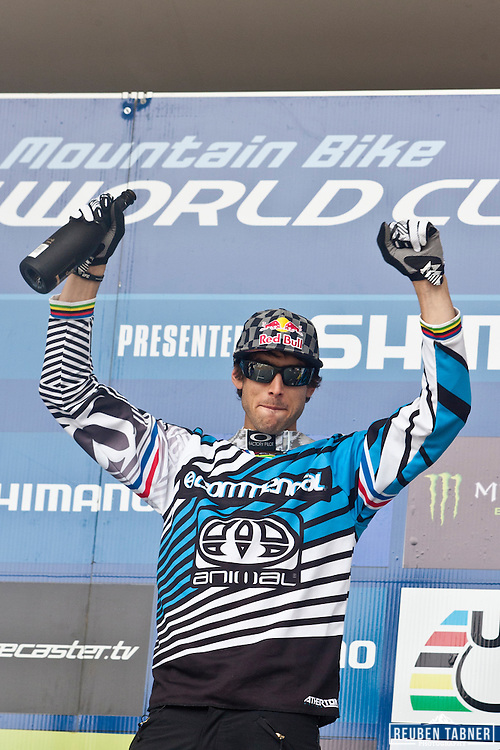 Gee Atherton (Great Britain) of team Commencal, is all smiles as he claims the number one spot on the podium. He finished in first (1st) place at the 2010 UCI Mountain Bike World Cup in Fort William, Scotland.