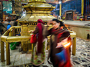 07 MARCH 2017 - KATHMANDU, NEPAL: People walk around the center of the Kamaladi Ganesh Temple, the most important Hindu temple dedicated to Ganesh, known as the overcomer of obstacles, in Kathmandu. In Hindu theology, Tuesdays are the best day to pray to Ganesh and the temple is very busy on Tuesdays. People frequently visit temples dedicated to Ganesh when they buy a new home or start a new job.     PHOTO BY JACK KURTZ