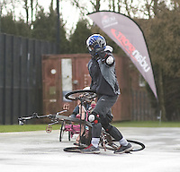 Blue Peter presenters have gone head-to-head on their personally modified bikes in a cycle race for Sport Relief 2014.  Radzi Chinyanganya breaks down just short of the finish line<br /> <br /> Photo by Chris Vaughan/CameraSport<br /> <br /> Commercial - Sport Relief -  publicity shoot - Tuesday 4th March 2014 - University of Central Lancashire Sports Arena - Preston<br /> <br /> © CameraSport - 43 Linden Ave. Countesthorpe. Leicester. England. LE8 5PG - Tel: +44 (0) 116 277 4147 - admin@camerasport.com - www.camerasport.com