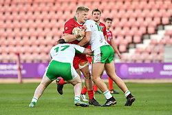 11th November 2018 , Racecourse Ground,  Wrexham, Wales ;  Rugby League World Cup Qualifier,Wales v Ireland ; Dan Fleming of Wales is tackled by Liam Byrne of Ireland <br /> <br /> <br /> Credit:   Craig Thomas/Replay Images