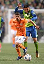 November 30, 2017 - Seattle, Washington, U.S - Soccer 2017: Sounder CRISTIAN ROLDAN (7) tries to defend against TOMAS MARTINEZ (25) as the Houston Dynamo play the Seattle Sounders in the 2nd leg of the MLS Western Conference Finals match at Century Link Field in Seattle, WA. (Credit Image: © Jeff Halstead via ZUMA Wire)